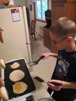 Luke making pancakes